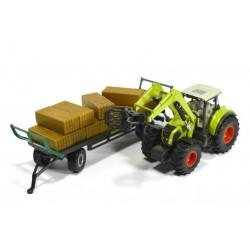 Claas Traktor mit Ballengreifer und Anhänger