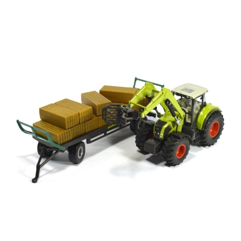 Claas Tractor met rechthoekige balengrijper en aanhangwagen